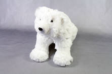 SMALL FURRY WHITE POLAR BEAR SITTING