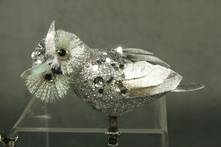 CUTE LITTLE SILVER OWL LOOKING LEFT