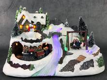 BATTERY LED CHRISTMAS HOUSE WITH SWING AND ROTATING TRAIN