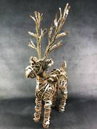 44CMH RATTAN AND STRING STANDING DEER WITH XMAS MIX