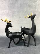 PAIR BLACK DEER WITH GOLD ANTLERS