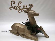 SILVER SITTING REINDEER WITH WREATH DECORATION AND LED LIGHT
