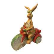 GIRL BUNNY ON ORANGE SCOOTER
