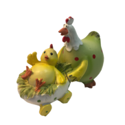 14CMH CHICKEN IN LIGHT GREEN OVERALLS PUSHING CHICK IN EGG
