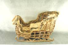 WICKER SLEIGH WITH FUR TRIM